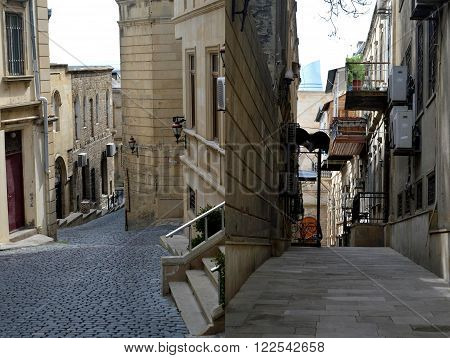 On a photo are represented city landscapes. These photos have been made in the territory of old fortress. Fortress has been constructed till the tenth century and it is located in the center of Baku.