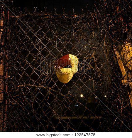 Vintage Mask on Rusty Steel Fence