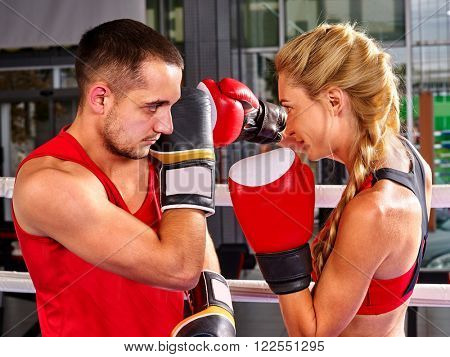 Couple Man and  Woman Wearing Gloves Boxing in Ring. Showdown.