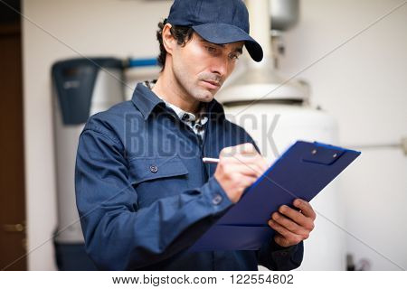 Plumber writing on a clipboard