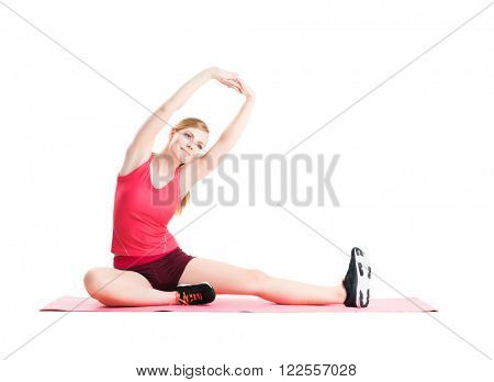 Fit, healthy and sporty woman in sportswear making physical exercises isolated on white.