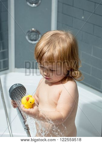 Boy With Duckling In Bath