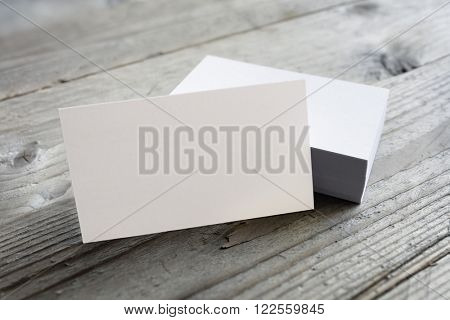 Business cards blank mockup on wooden background