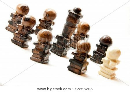 Handmade chess pieces made of pieces of chalk.