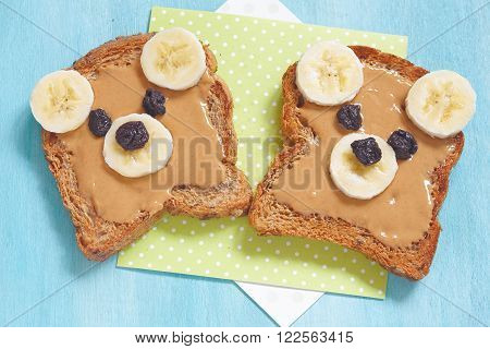 Bear cubs made of whole wheat bread with peanut butter, banana and raisins poster