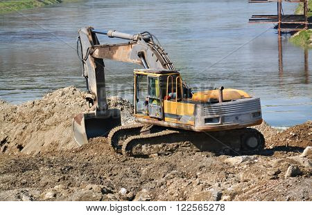 Closeup of a dredger during the work at the construction site