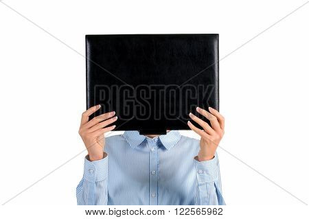 Lady's face covered with folder. Woman holding black leather folder. Mysterious girl covering her face. Intriguing photo of a woman.