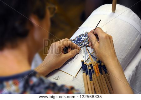 the woman lace-maker at work traditional lace making crafts folk art selective focus