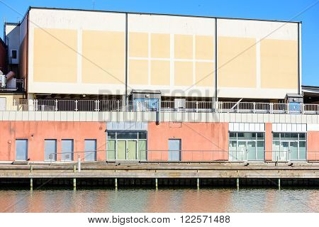 Industrial building at the dockside in the harbor. Copy space on building.