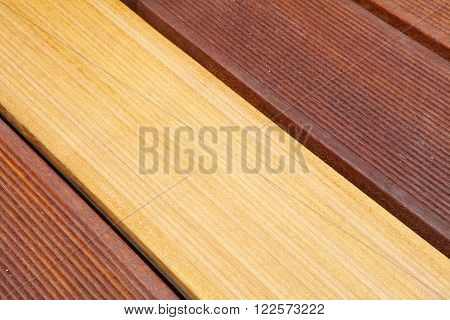 four differently painted bankirai wood planks as closeup