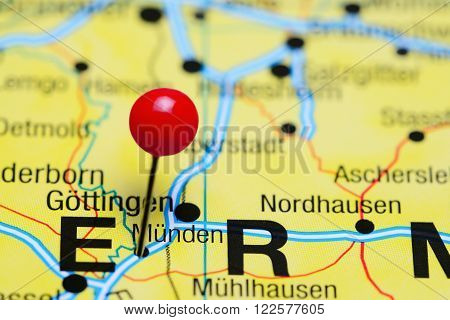 Photo of pinned Munden on a map of Germany. May be used as illustration for traveling theme.