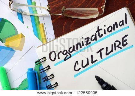 Organizational Culture written in a notepad. Business concept.