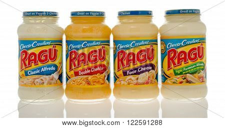 Winneconne, WI - 6 Dec 2015: Four jars of different flavored cheese sauces from Ragu.