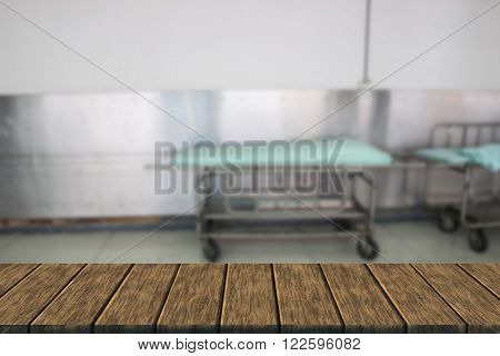 stretcher gurney for patient in hospital (blur background and wooden table for displaying your product)