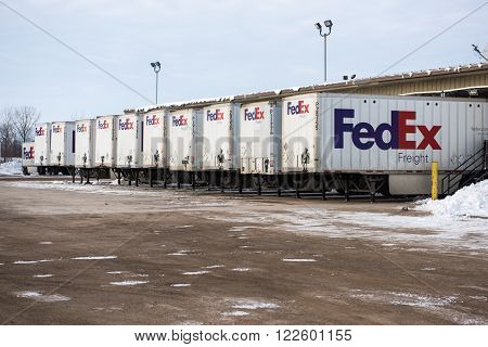 Winneconne, WI - 1 Jan 2016: Federal Express trailers parked at loading docks that specialize in freight items.