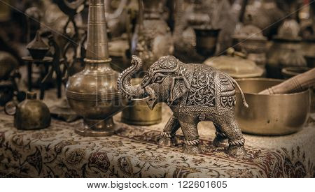 Detailed close-up elephant figurine made of metal. Copper utensils and souvenirs. Royal treasures. National souvenir. Jordanian souvenir shop.