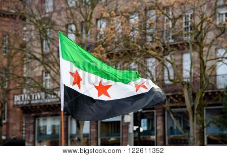 STRASBOURG FRANCE - MAR 19 2016: Syrian flag waving during protest