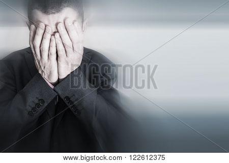 Depressed Caucasian Male in Elegant Black Suit. Depression of Businessman.