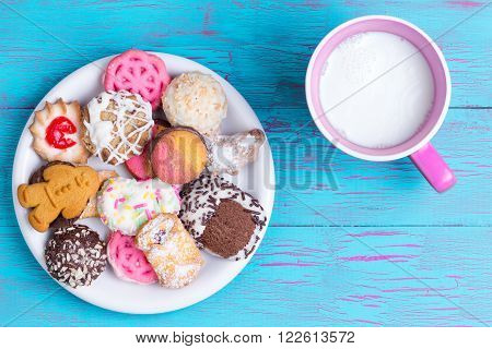 Plate With Various Cookies And Milk