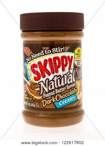 Winneconne WI - 3 May 2015: Jar of Skippy Natural peanut butter with dark chocolate in creamy style.