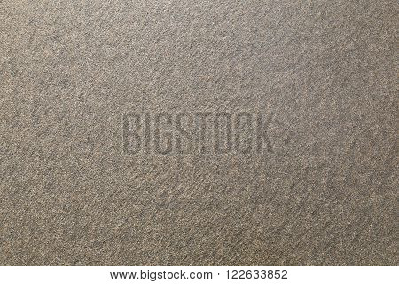 background of small homogeneous gray sand on the seashore. texture.