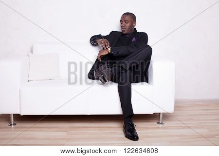 African american business man in black suit over white background