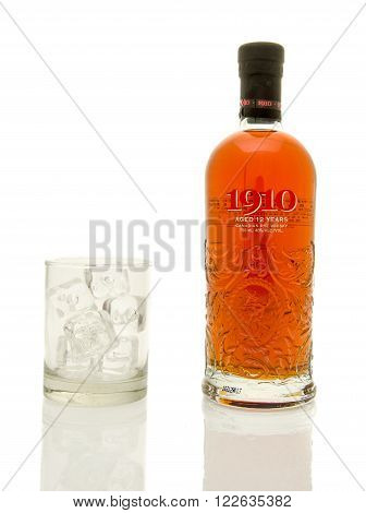 Winneconne WI - 19 March 2016: A bottle of 1910 canadian rye whisky with a glass of ice.