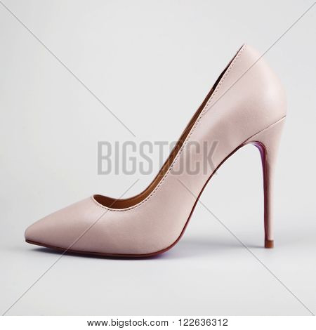 Pink high heel women shoes on white background