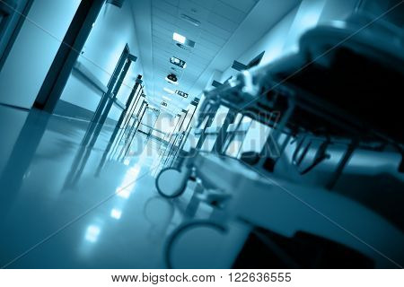 Empty gurney in a long corridor in hospital
