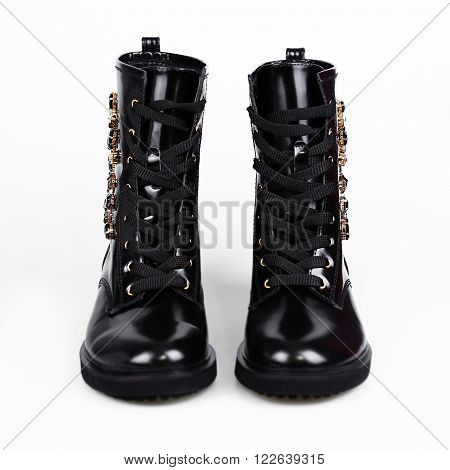 Stylish leather boots shot in studio isolated on white