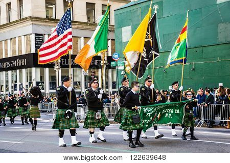 NEW YORK-MARCH 17- Marchers with flags dressed in kilts march in the St Patrick's Day Parade on on 5th Ave in New York City.
