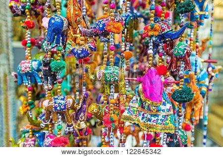 The wind chimes with elephants camels and parrots are the traditional Eastern decoration and popular tourist souvenir Jerusalem Israel. poster