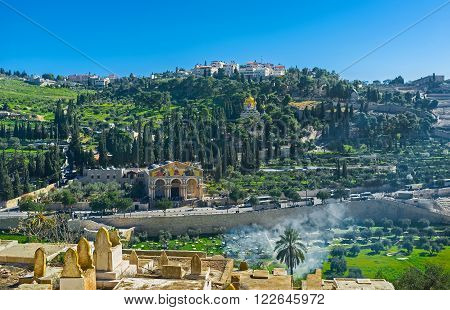 The view from the Muslim Cemetery on the of Mount of Olives with the Gethsemane Garden Churches of All Nations Mary Magdalene and Dominus Flevit Jerusalem Israel.