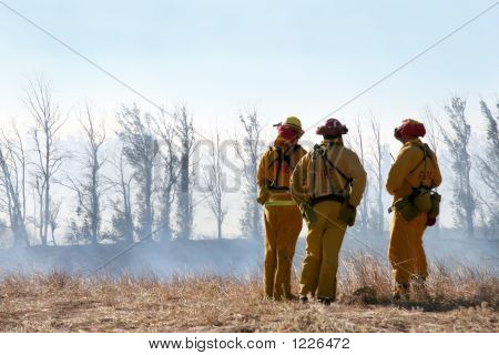 Firemen Looking At Damage
