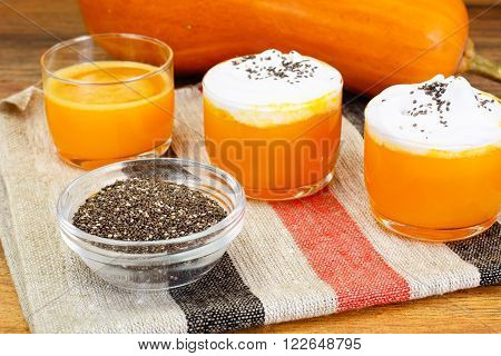 Pumpkin Juice Latte with Whipped Cream and Chia Seeds Studio Photo