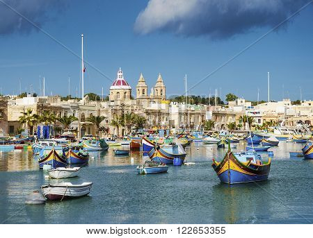 marsaxlokk harbour and traditional mediterranean fishing boats in malta island