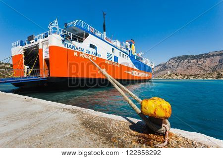 Greece, Panormitis-July 14 2014: The ferry at the pier in the harbor on July 14, 2014 in Panormitis, Greece