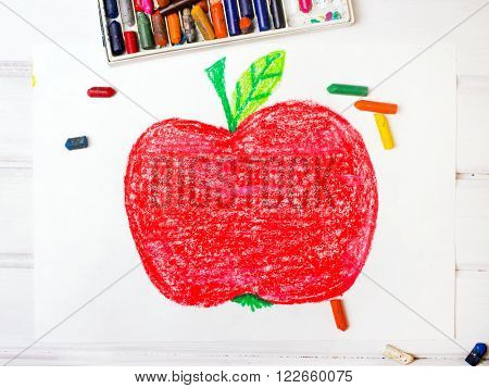photo of a colorful drawing: big red apple
