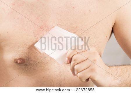 Waxing man torso cosmetic depilation epilate hair France