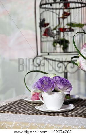 Brunch of blossom eustoma flowers in a white cup