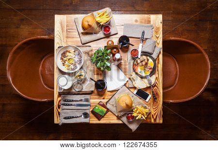 Table at a restaurant with served food, view from above