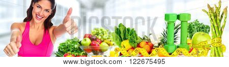Young woman over fruits background.