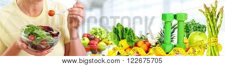 Senior woman eating vegan salad.