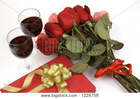 Roses With Present And Wine