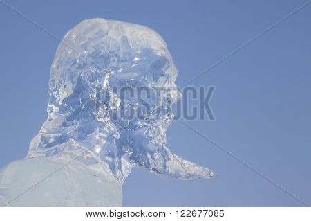 Harbin China 01/21/2016 Confucius head made from ice at the ice festival on sun island on a sunny day