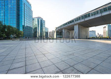 marble floor front of modern buildings in beijing