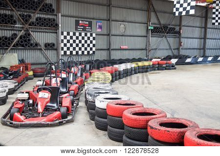 O'CONNOR,WA,AUSTRALIA-MARCH 5,2016: Indoor Kart Hire location with go karts, checkered flags and colourful tire boundaries in O'Connor, Western Australia.