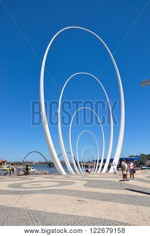 PERTH,WA,AUSTRALIA-FEBRUARY 13,2016: Spanda public sculpture by Christian de Vietri at Elizabeth Quay with tourists in Perth, Western Australia.