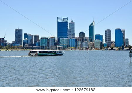 PERTH,WA,AUSTRALIA-FEBRUARY 13,2016: Transperth ferry transport on the Swan River with urban architecture in Perth, Western Australia.