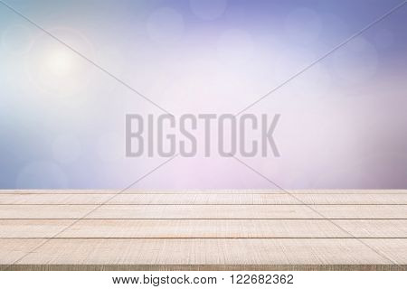 Beige wood table top panel on pastel blurred background in sweet tone with violet pink purple white bright sunlight use for display or montage products for advertisement in sweet concept